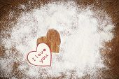 foto of home is where your heart is  - Heart of white flour on a wooden board - JPG