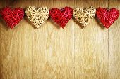 Five beautiful romantic vintage hearts on a wooden oak background. Love and St. Valentines Day concept.