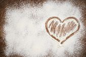 image of home is where your heart is  - Heart of white flour on a wooden board - JPG