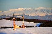 Abandonned wind turbines in winter landscape - sunset light