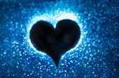 Heart Silohuette On A Blue Bokeh Background