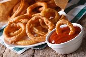 Onion Rings In Tomato Sauce Closeup. Horizontal On The Table