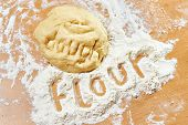 Funny Knead Dough And Flour On Wooden Table With Text