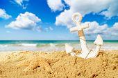 Anchor and starfish on a summer beach