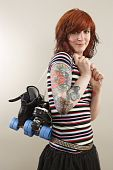 picture of roller-derby  - Photograph of a roller derby girl holding her skates by the laces - JPG