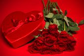 A Valentine Candy Box and red Roses on Red Background