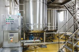 pic of pharmaceuticals  - Water conditioning or distillation room with control panel equipment and water boiler or tank on pharmaceutical industry or chemical plant - JPG