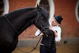 foto of horse girl  - Portrait of the girl and black horse - JPG
