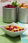 foto of fruit bowl  - Vertical photo of modern square white bowl with cornflakes inside with dried berries - JPG