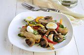 stock photo of quail egg  - Chicken and mushroom salad with quail eggs and fresh herbs - JPG