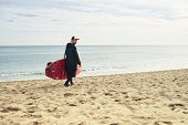 picture of paddling  - Man with stand up paddle board or sup on the beach - JPG
