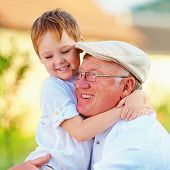 picture of grandpa  - portrait of happy grandpa and grandson having fun outdoors - JPG