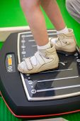 pic of vibrator  - child feet on a vibrating training platform - JPG