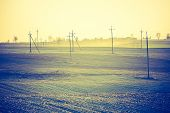 stock photo of plow  - Vintage photo of plowed field in calm countryside - JPG