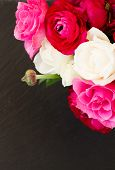 stock photo of bunch roses  - bunch of pink  ranunculus and rose flowers  close  on black background - JPG