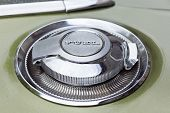 foto of muscle-car  - Fuel Cap of vintage american car from the late 1960s - JPG