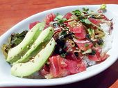 stock photo of avocado  - Closeup of delicious plate of Japanese white rice raw ahi tuna fish fresh seaweed avocado sprouts and sesame seeds - JPG