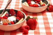 image of fruit bowl  - A bowl of delicious fresh fruit and Neapolitan ice cream served as a gourmet dessert after a hearty meal - JPG