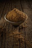picture of black tea  - Black tea with spices for Garam Masala Chai Tea against wooden background - JPG
