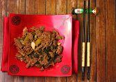 foto of stir fry  - Vietnamese beef stir fry served on a wood table top - JPG
