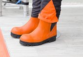 stock photo of industrial safety  - Pair of new protective gummy boots for industrial workers - JPG