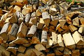 stock photo of firewood  - Background of dry firewood logs in a pile - JPG