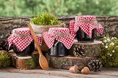 image of three life  - Still life with three jars of fruit jam and decoration in rustic style - JPG
