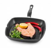 stock photo of salmon steak  - Frying pan with salmon steak - JPG
