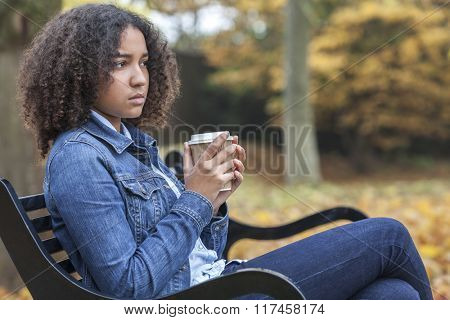 Beautiful mixed race African American girl teenager female young woman drinking takeaway coffee outs