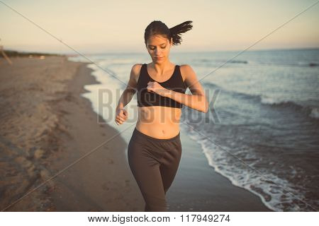 poster of Beautiful fit female fitness woman training and working out outside in summer