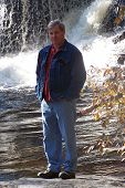 Man By Waterfall