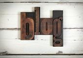 blog, written with old wooden letters. The word blog, written with vintage letterpress type on whi poster