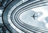 Постер, плакат: Modern Architecture Building With Landing Airplane