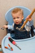 Baby Boy Playing With Hammer