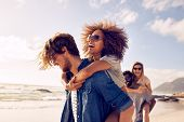 Постер, плакат: Young Friends Enjoying A Day At Beach