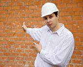 Builder   Pointing To    Brick Wall