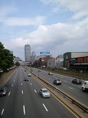 Cars Roll Down Highway In Boston Next To Fenway Park