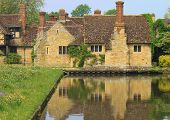 stock photo of hever  - Surrounding buildings refelcted in the moat around Hever Castle - JPG