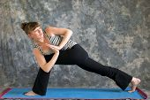 Woman Doing Yoga Posture Parivrtta Parsvakonasana Or Revolved Extended Side Angle Pose