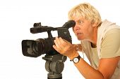 Professional video camera and elderly camera woman on white background