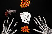 pic of derringer  - Playing cards aces and eights dead mans hand skeleton hands derringer and candy corn as poker chips - JPG