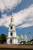 Nicholas Naval Cathedral In The Background Of Blue Sky With Clouds. St. Petersburg