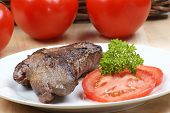 Grilled Ostrich Steak With Parsley On A Plate
