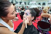 MOSCOW - OCTOBER 2: Professional visagiste makes body art at XVII International Festival
