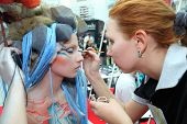 MOSCOW - OCTOBER 2: Artist makes body art for model wear attire