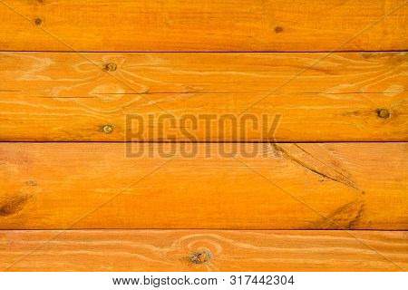 poster of Wall Of A Log House. Log-house. Wall Of Painted Orange Logs. Wood Background. Country Style.