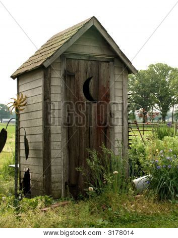 Picture or photo of old wooden outhouse in a garden with for Outhouse pictures