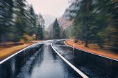 Road In The Autumn Forest In Rain With Motion Blur Effect poster