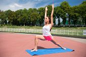 Woman Healthy Body Practice Yoga Outdoors Nature Background. Girl Stretching Workout. Stretching Mus poster