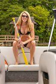 A gorgeous bikini model enjoying a day on the water poster